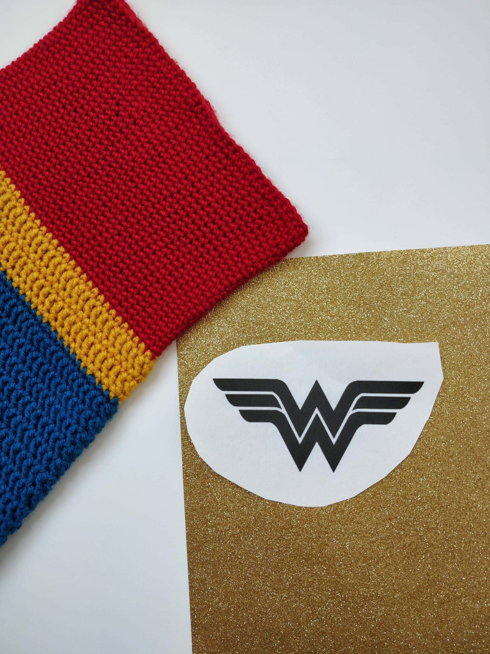 Wonder woman logo against gold background