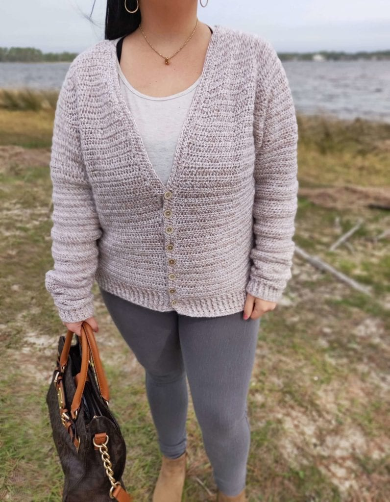 Woman modeling the Envision Cardigan by The Velvet Acorn at the grassy beach on the Gulf of Mexico