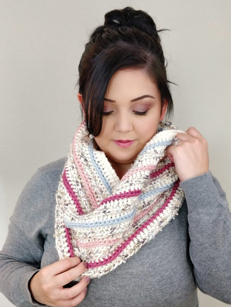 Ariana Hall looking down while wearing the crotchet cowl