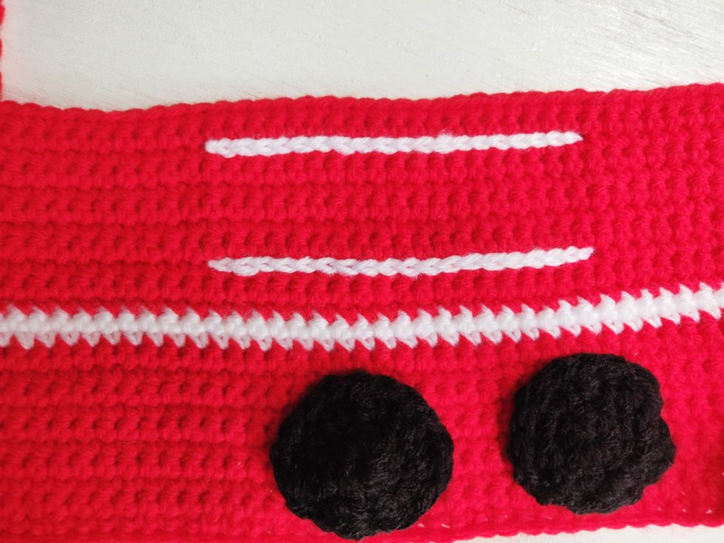 Top and bottom of the ladder stitched onto the red fire truck crochet pattern