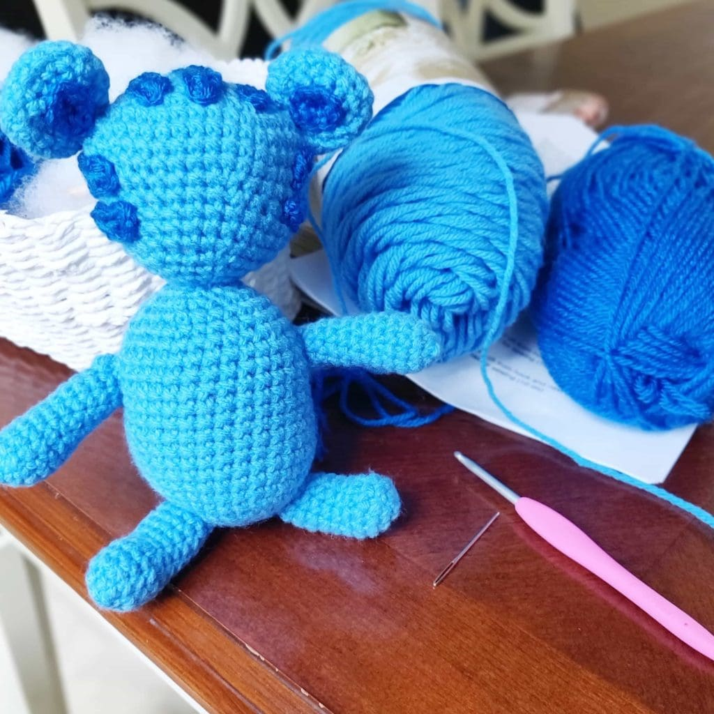 Tigey crochet doll with dark blue hair added for detail