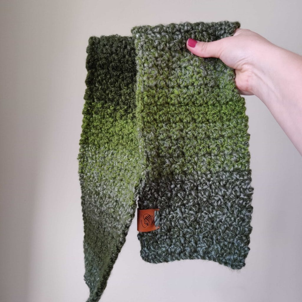 Easy kids scarf being held up for display in Forrest green color