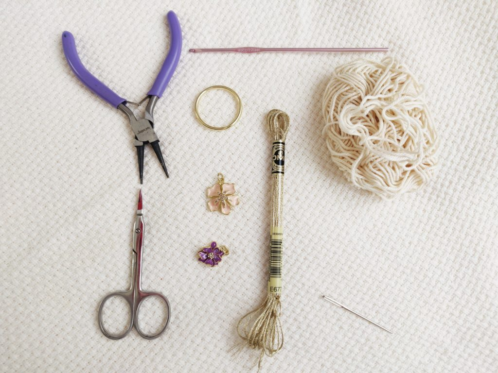 Crochet and sewing tools and equipment laid out for a project
