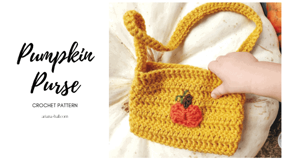 Small gold crochet purse with a small pumpkin applique in the center.