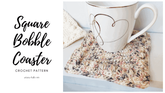 Square crochet coaster with light colors.