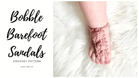 Crochet baby bobble barefoot sandal worn by a baby.