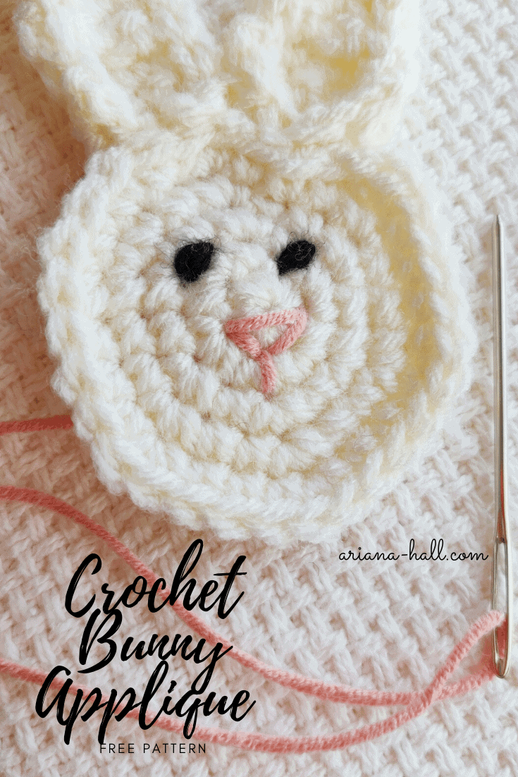 Completed crochet bunny applique with black eyes and pink nose. Graphics showing the work done by Ariana Hall from ariana-hall.com against a woven fiber background.