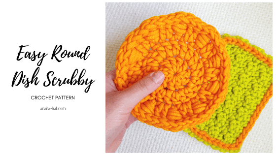An orange crochet dish scrubby with double crochet stitches.
