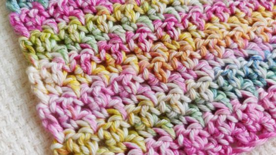 Multi-colored crochet washcloth.