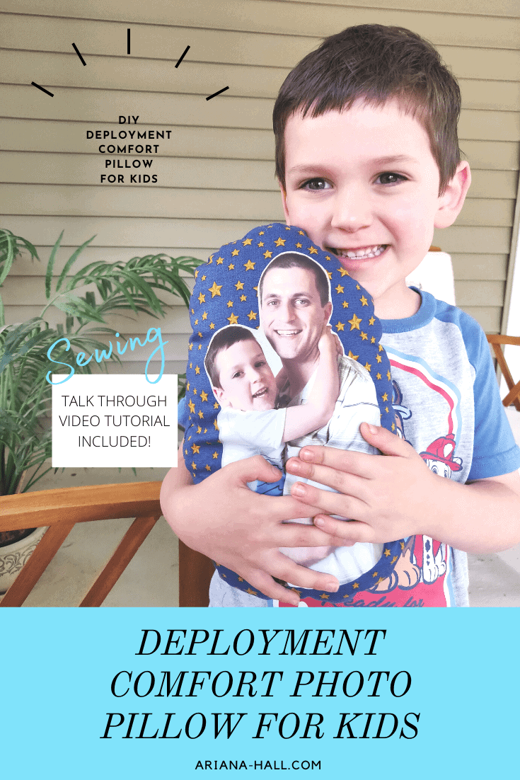 Little boy holding a pillow with dad's face on it.