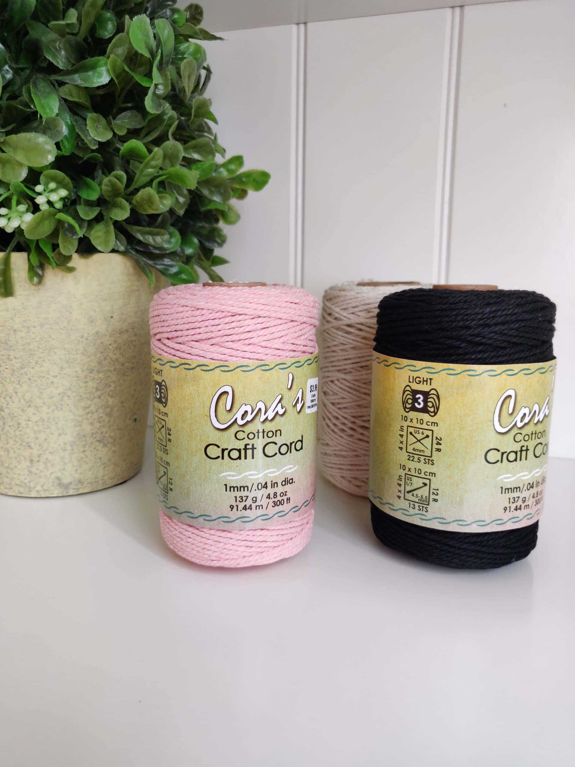 Black, pink, and natural cotton cord
