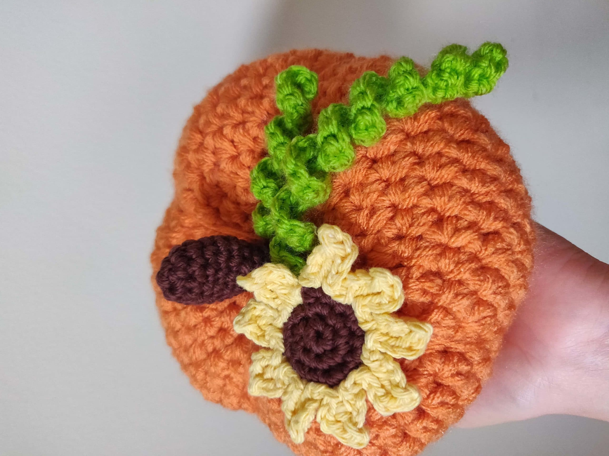 Crochet pumpkin with sunflower.