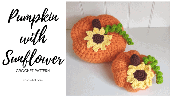 two crochet pumpkins with sunflowers and green vines.