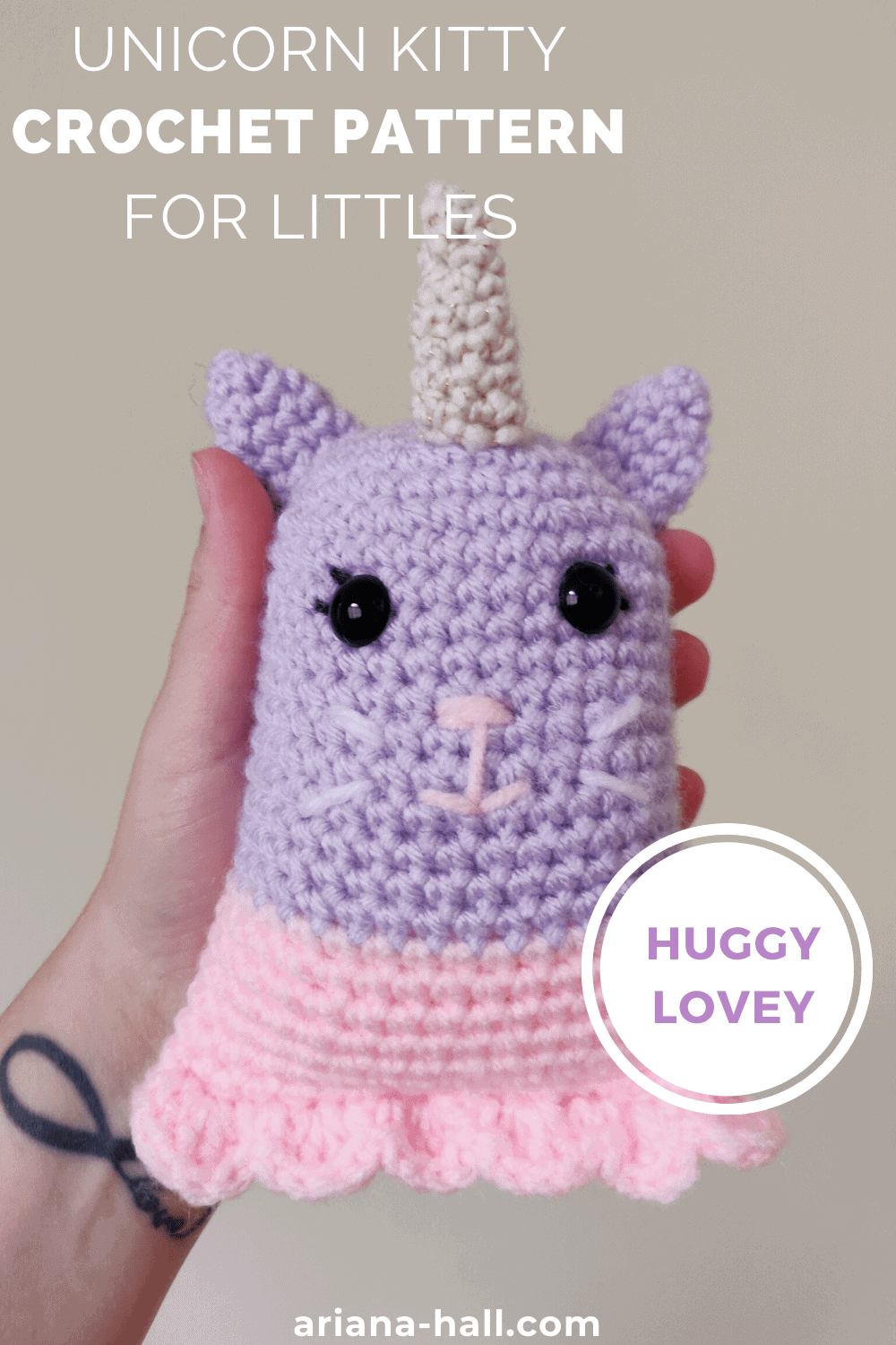 A pink and purple crochet unicorn kitty.