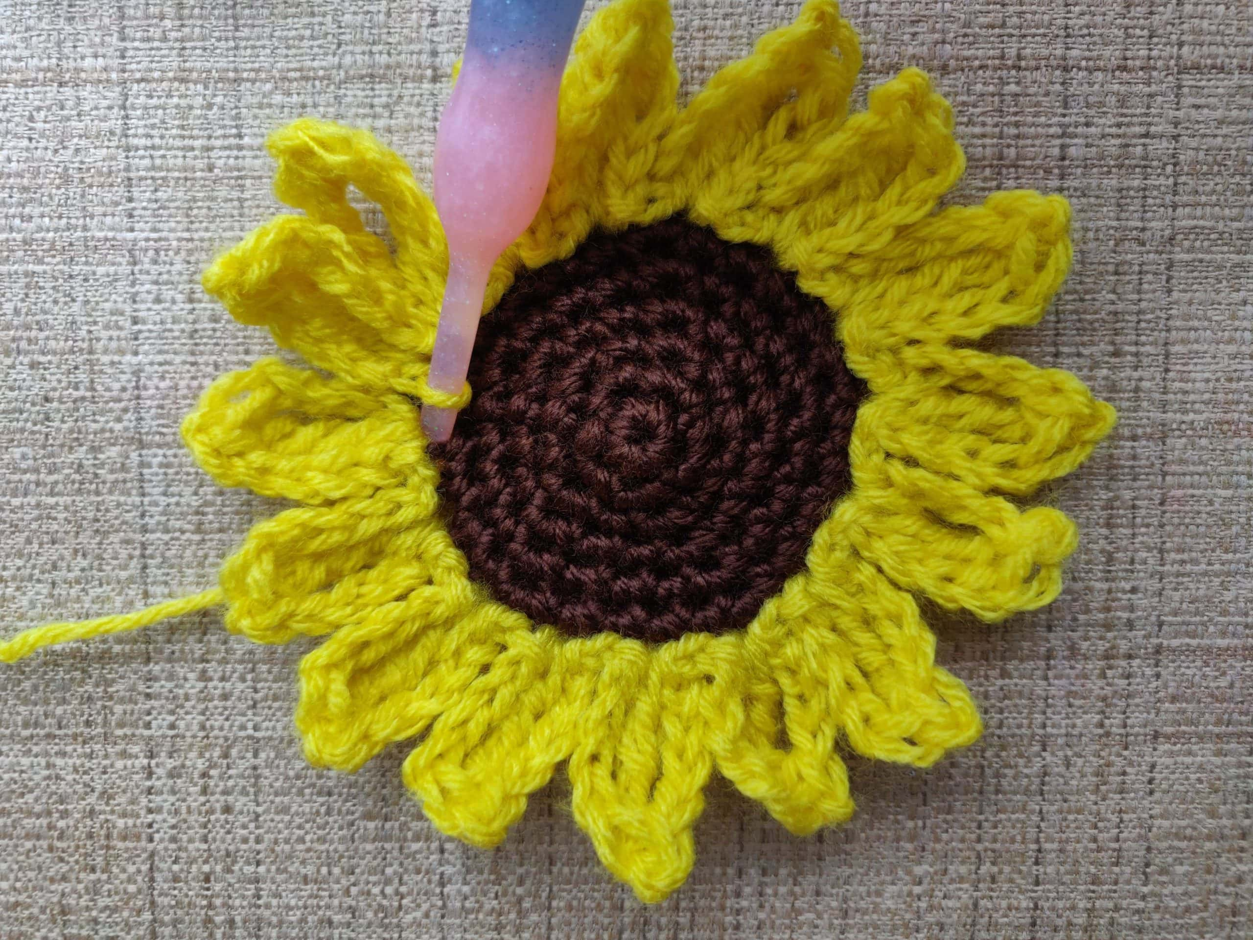 crochet sunflwoer applique. Brown and yellow yarn.