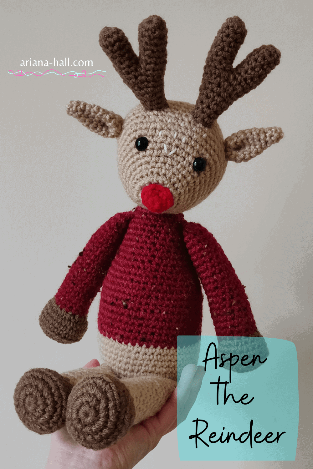Crochet reindeer inspired by rudolph in a red sweater.