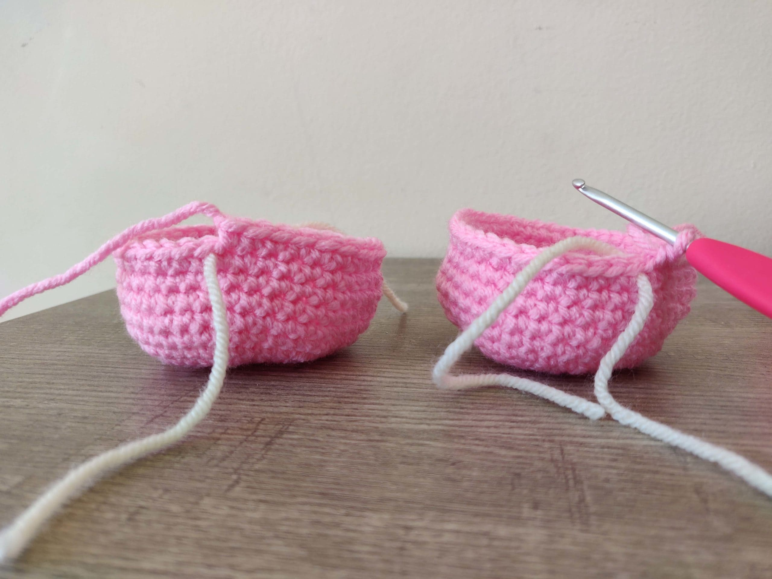 Two crochet pieces in Pink color yarn.