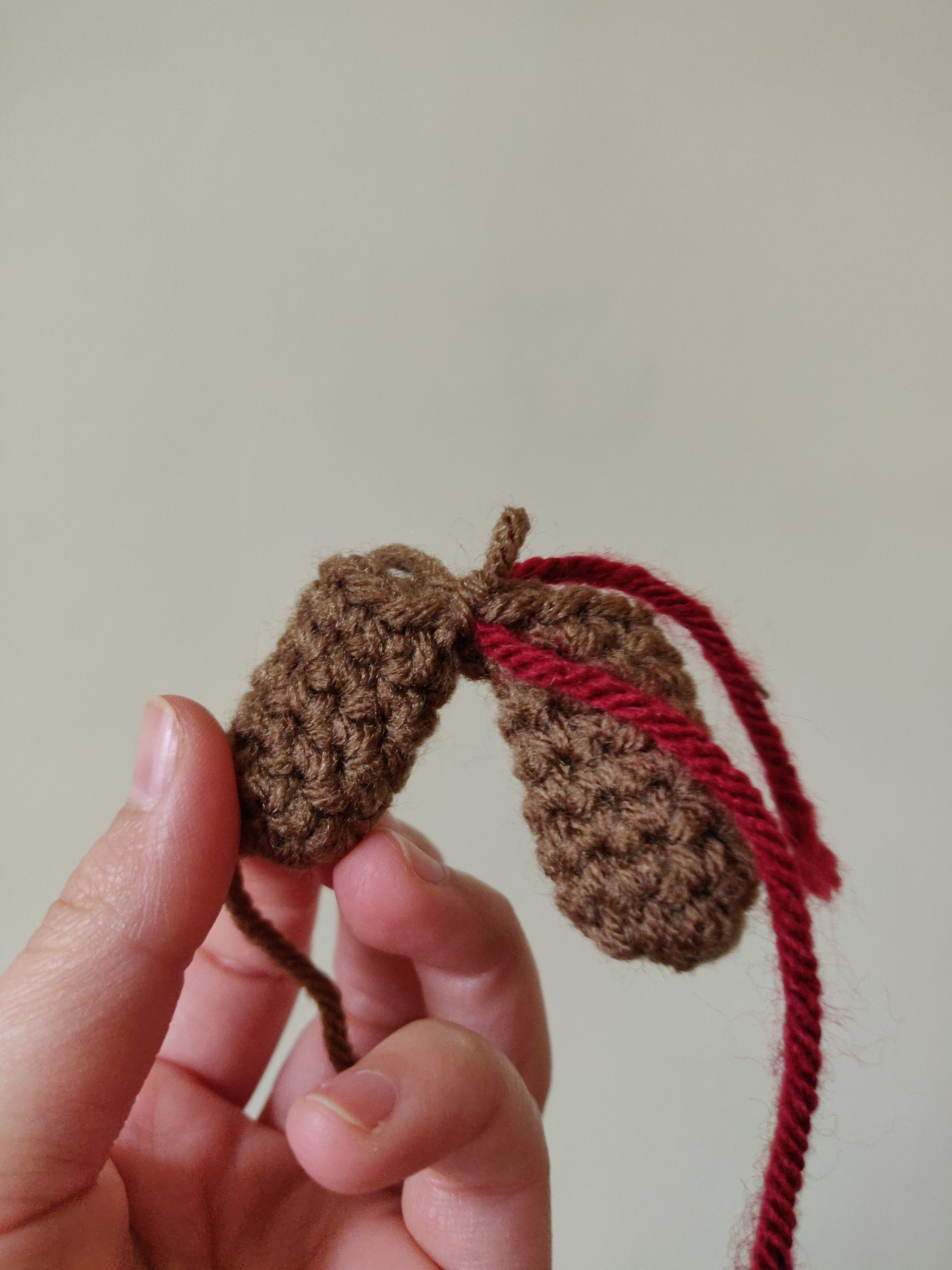 Process of brown crochet reindeer antlers.