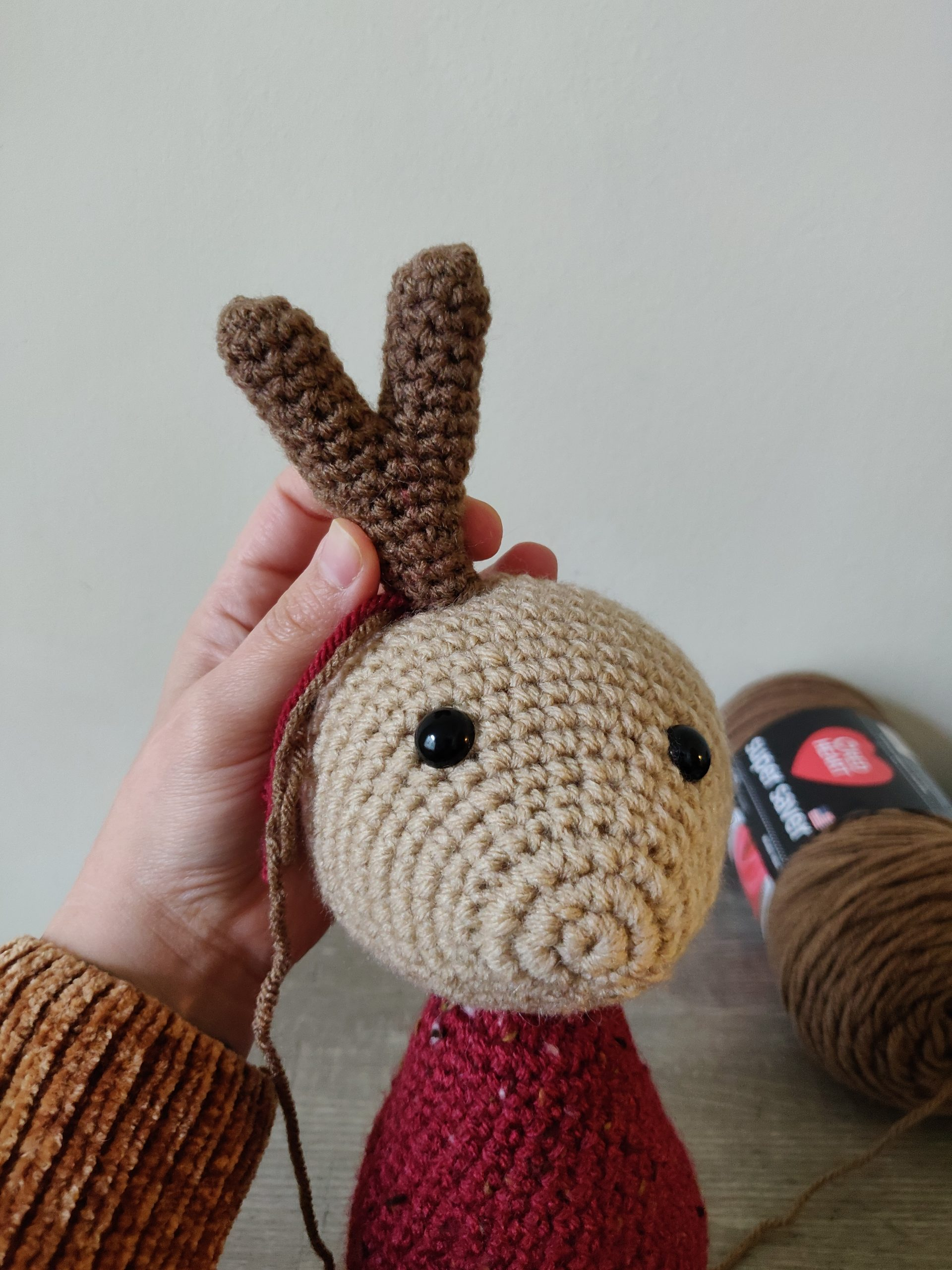 Crochet antlers on crochet reindeer.