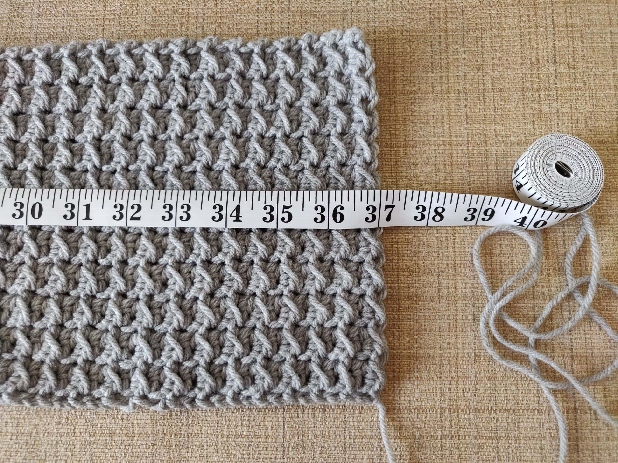 Measuring the length of the crochet scarf.