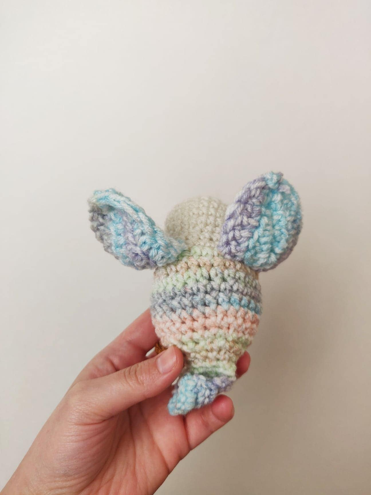 Crochet bird with wings up.