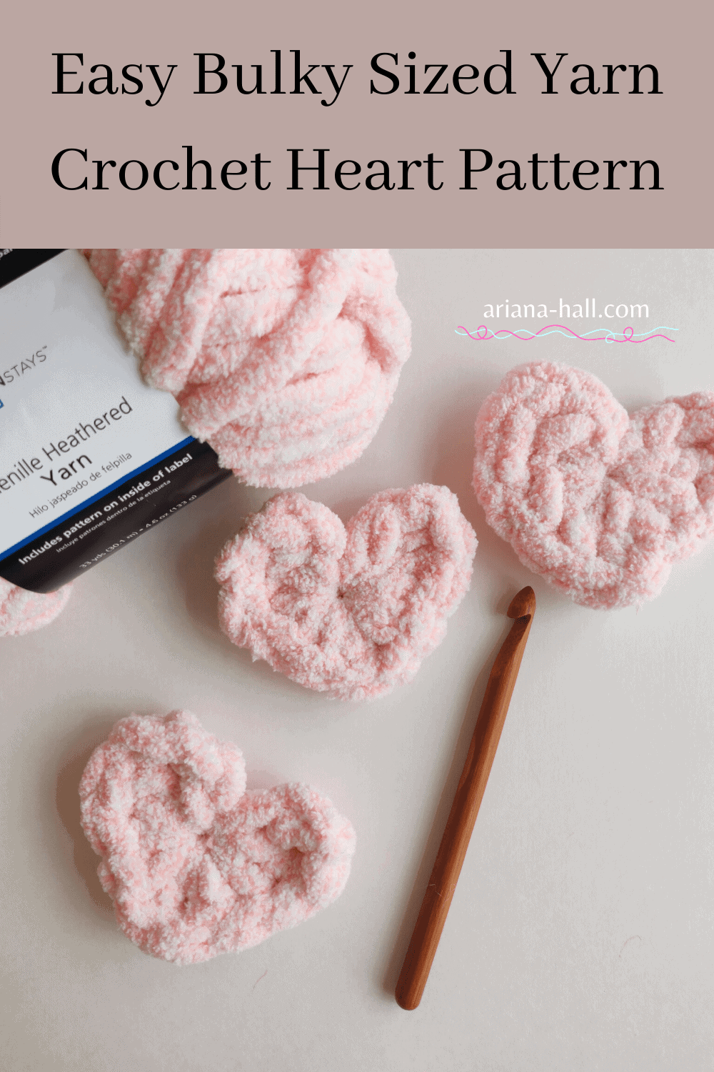 Three pink crochet hearts with bulky yarn and wooden crochet hook.