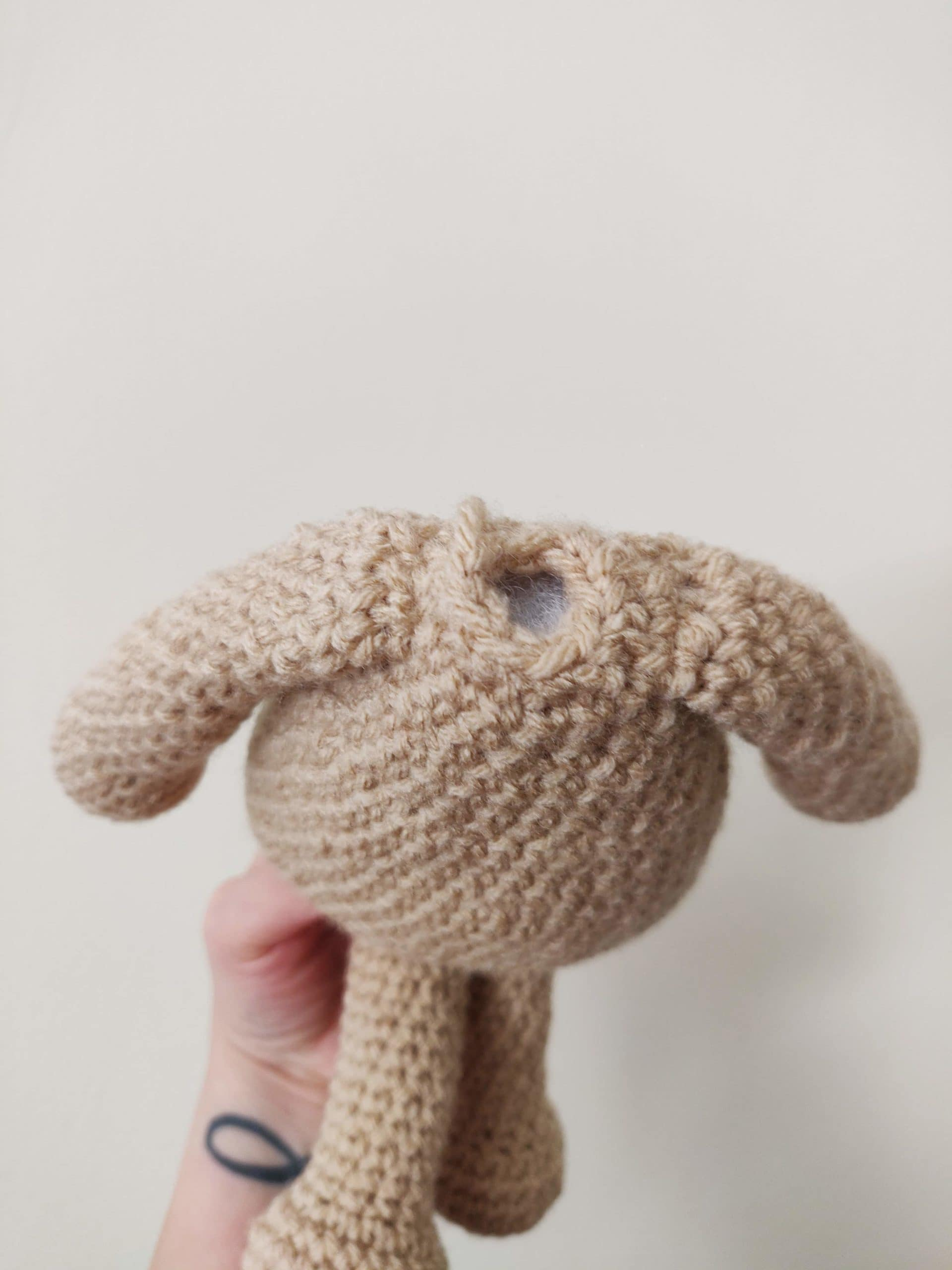 Crochet body of pup with all four limbs.
