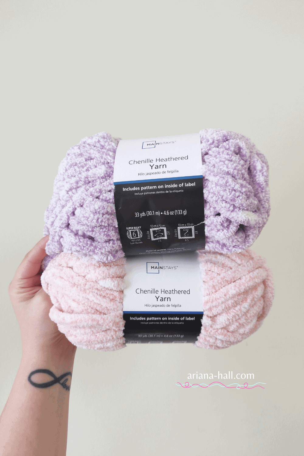 One pink and one purple skeins of yarn.