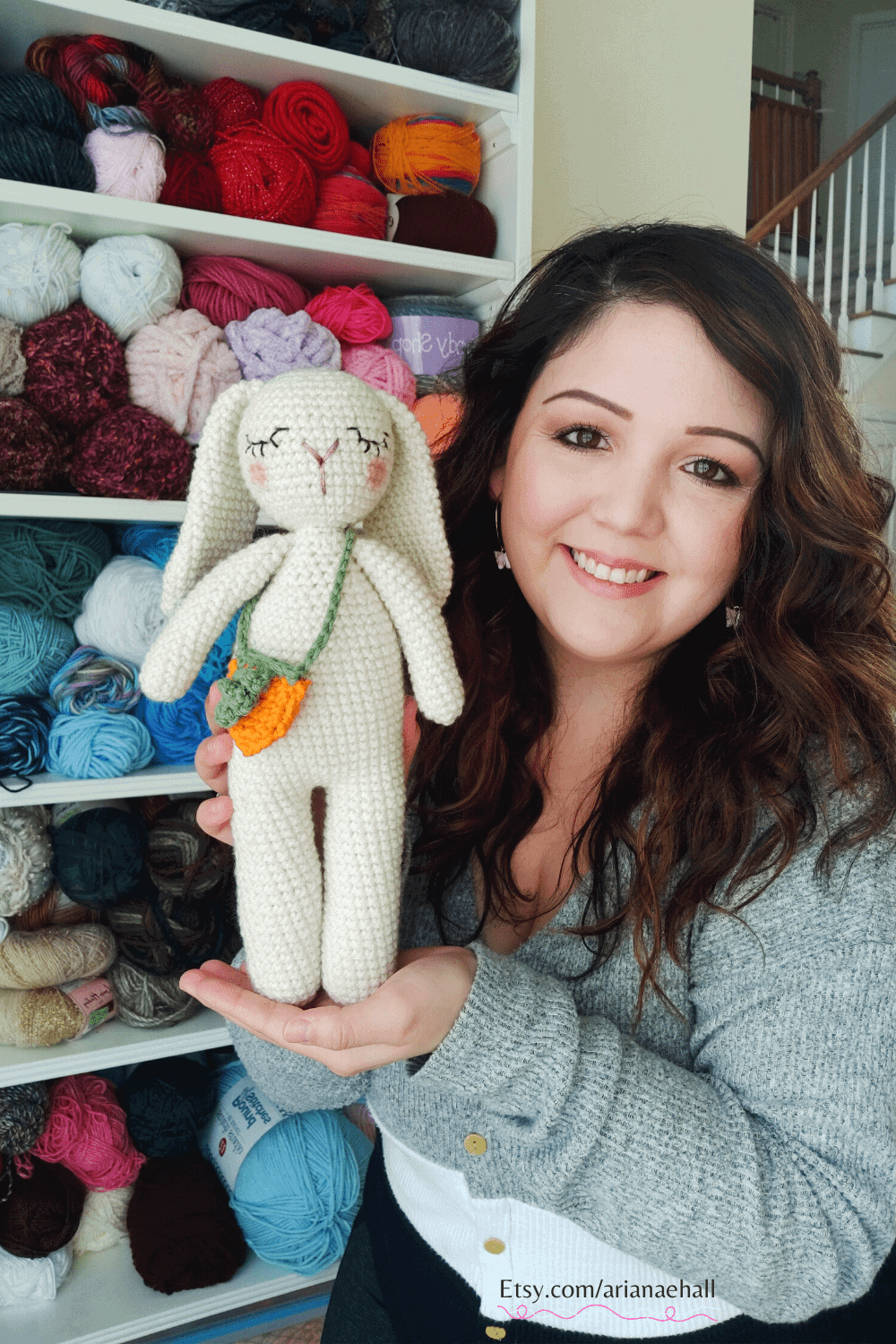 Woman holding a white crochet bunny on the left.
