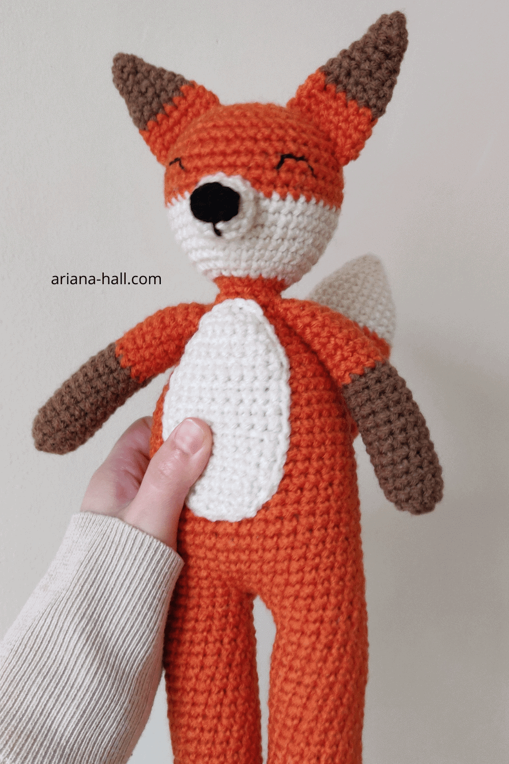 Orange crochet Fox with arms, nose, and ears on.