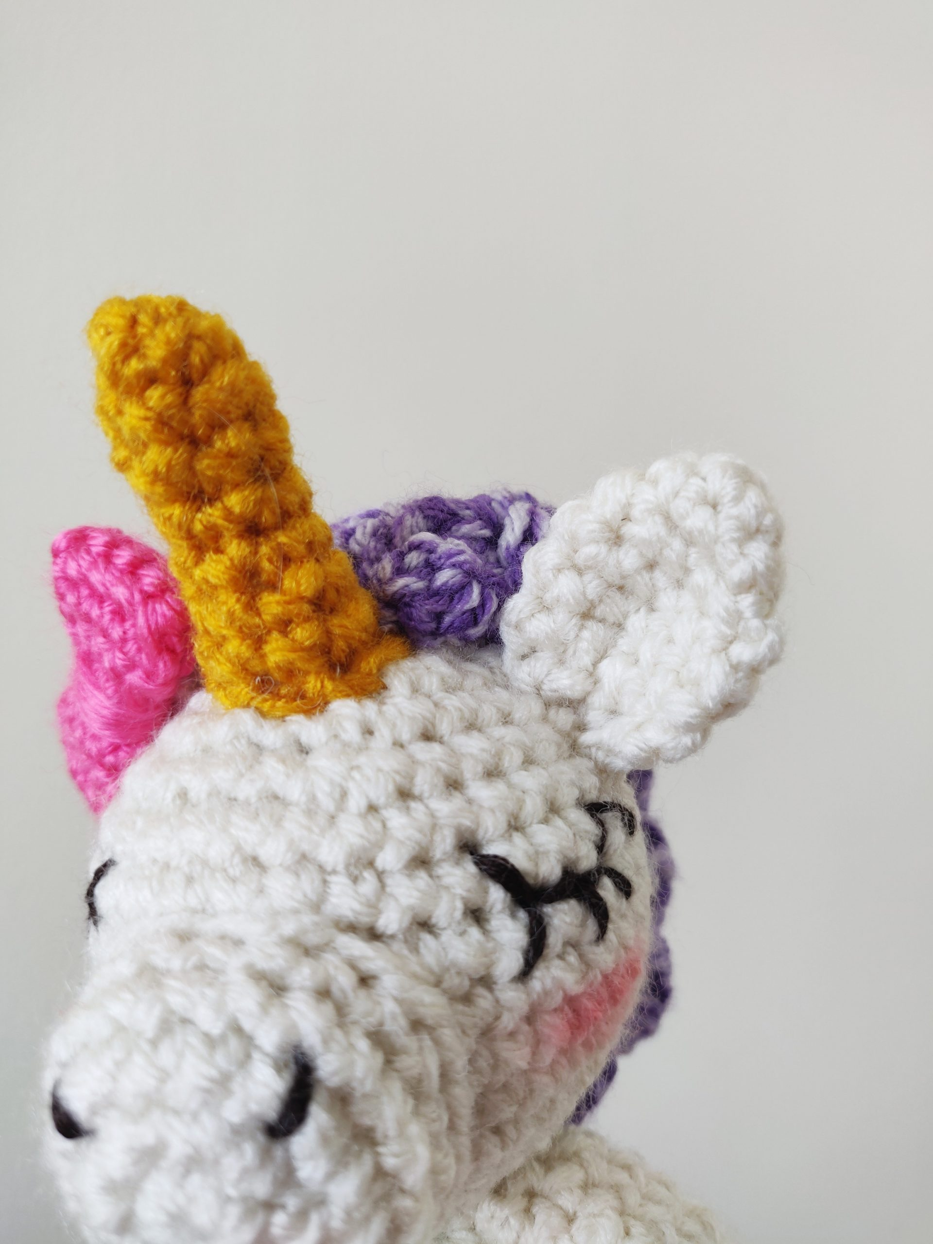 Crochet unicorn with gold horn and pretty ears.