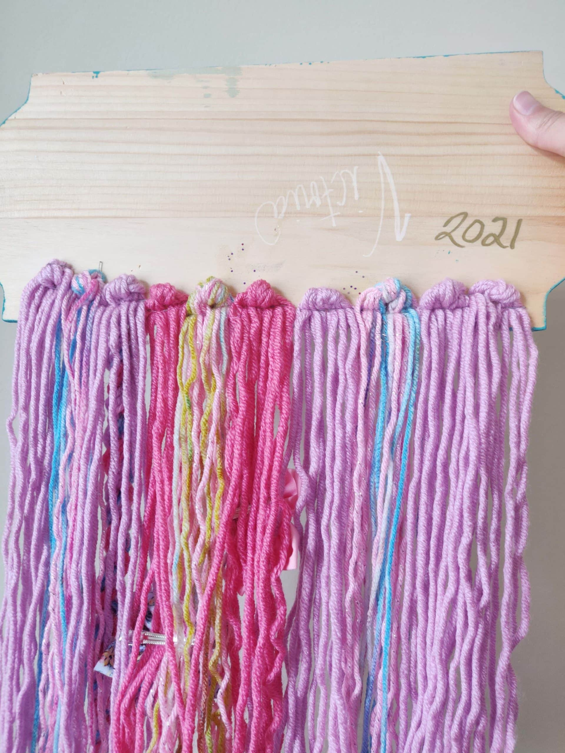 10 sets of 6 strands of pink and purple yarn