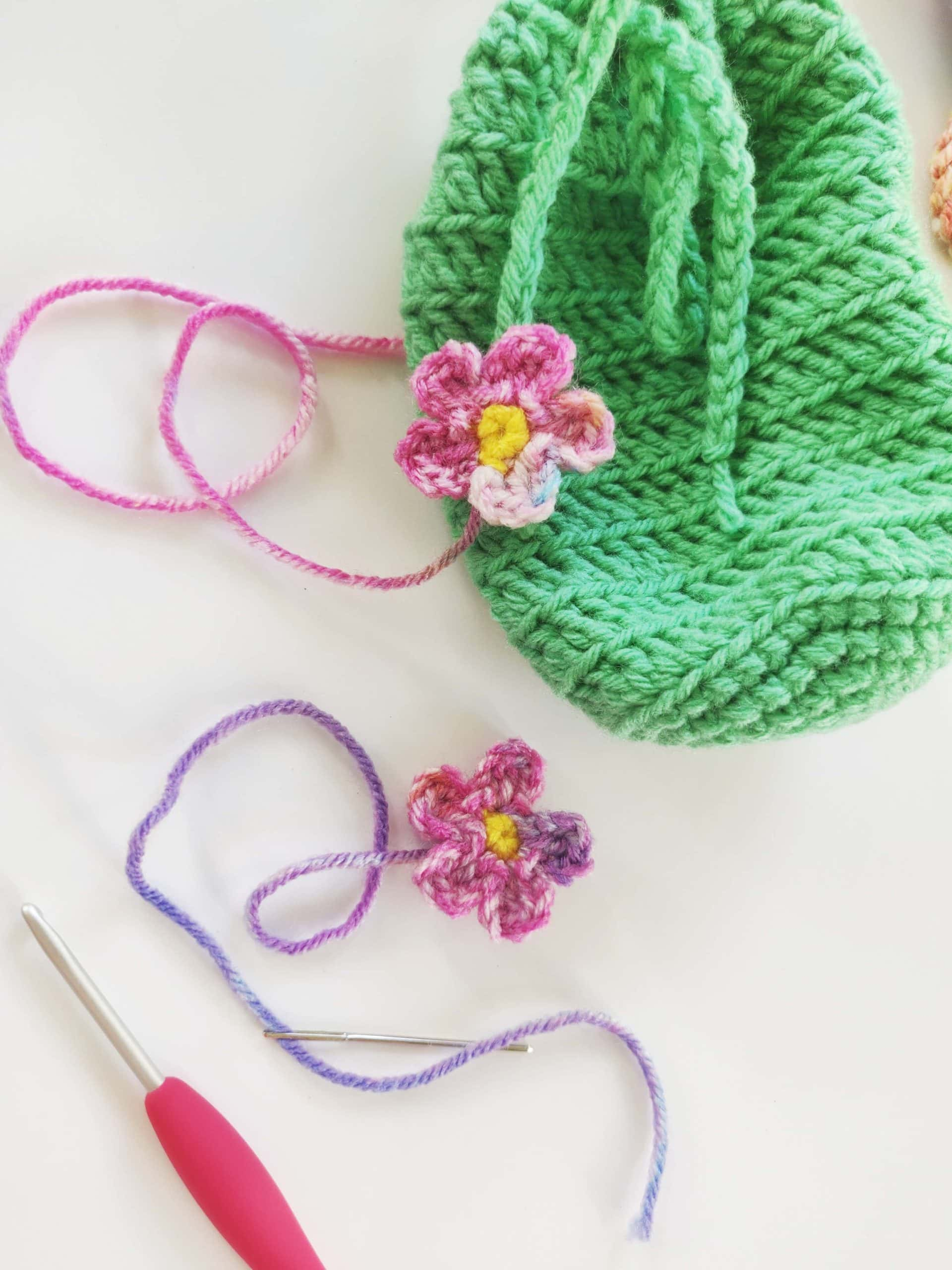 Two crochet flowers going to be sewn on the green ties.