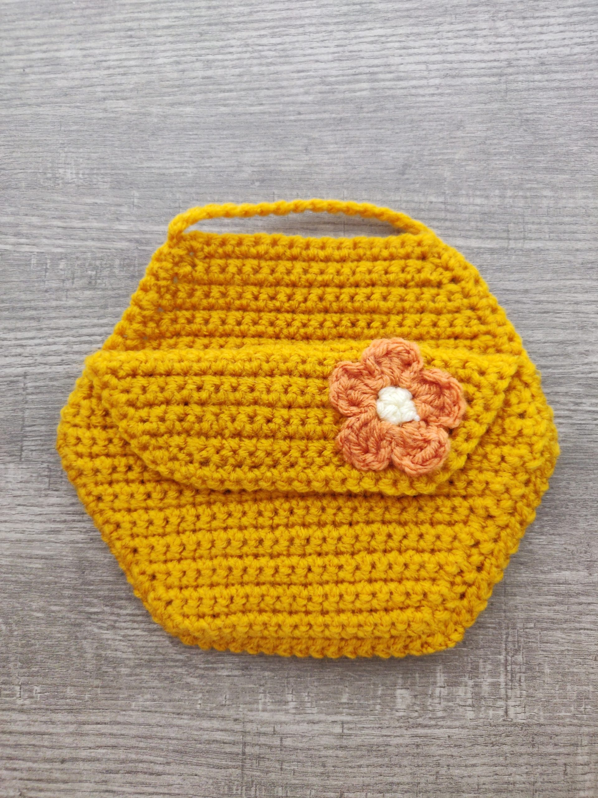 Gold honey comb bee holder with an orange flower.